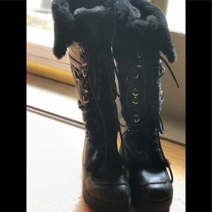 Report Black furry lace up boots size 9!